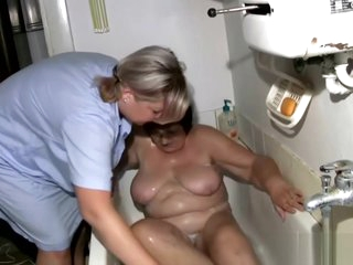 Nurse is bathing naked granny