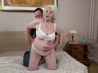 Grandma porn star Norma fucking a young man 2.