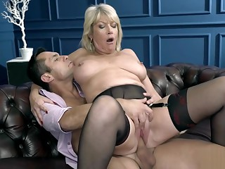 Foxy blonde cougar fucked by a stud