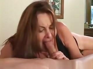 Sexy Brunette Milf Blows Stiff Cock