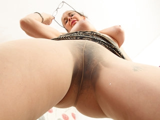 English gilf Josie covers hairy fanny with sheer tights