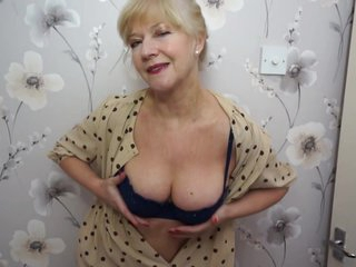 Mature blonde woman is using her favorite glass dildo to keep her sexual needs satisfied