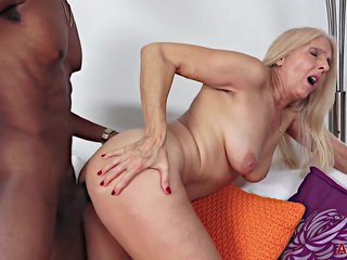 Seductive, blonde granny decided that it was time for her to have her first black experience